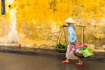HOI AN, QUANG NAM, VIETNAM - JANUARY 03, 2019: Vietnamese woman street seller In hoi an Vietnam in ancient town HoiAn