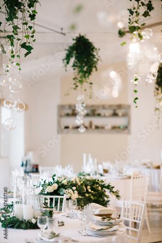 Leinwandbild Motiv Wedding dinner table set. Classy white decor with greenery