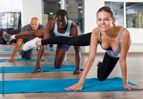 Leinwandbild Motiv People doing stretching exercises