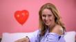 Leinwandbild Motiv Pretty blond woman looking to camera, tempting man on Valentines day, flirting