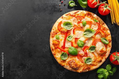Tasty vegetarian pizza on dark background - 247654718