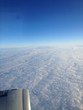 Clouds and sky as seen through window of an aircraft. - 247662575