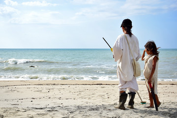 Indigenous people looking at the ocean in Colombia