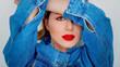 Closeup portrait of a beautiful woman in blue jeans
