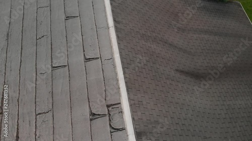 Weathered Shingles and Damaged Flat Roofing on Residential Home AERIAL ROTATE SLOW MOTION