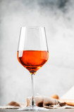 Trendy food and drink, orange wine in glass, gray table background, space for text, selective focus vertical image - 247688167