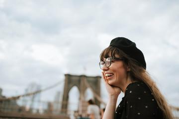 Cheerful woman on the Brooklyn Bridge, USA