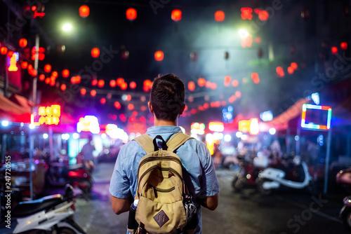 Leinwandbild Motiv Traveler exploring Asian food market street