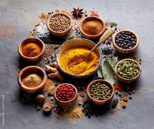 Traditional spices and herbs on black board © Dionisvera