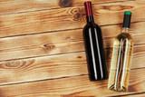 bottle of wine over wooden background - 247724556