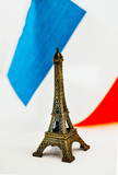 Metal Eiffel Tower and French flag on background - 247737368