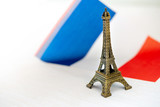 Metal Eiffel Tower and French flag on background - 247737381