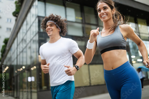 Couple jogging and running outdoors in city
