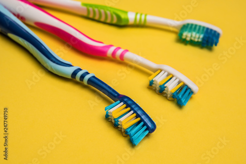 multicolored toothbrushes. copy space. - 247749750