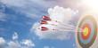 Leinwanddruck Bild - Zielscheibe mit 3 Pfeilen vor einem blauen Himmel