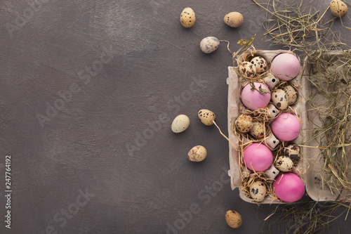 Leinwandbild Motiv Easter background. Colored eggs on gray stone surface