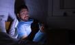 Leinwanddruck Bild - Man using smartphone, surfing net late at night
