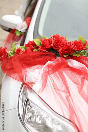 decoration on the wedding car. red rose