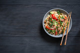 .Thai noodle wok with chopsticks on a black wooden background with a place for copy space - 247783389