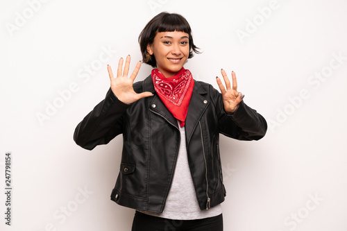 Leinwanddruck Bild Woman with leather jacket and handkerchief counting eight with fingers