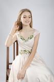 National wear. Ukrainian. Beautifil model in dress on white background.