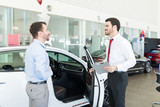 Man Buying New Car From Dealership Center - 247837309