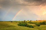 Rainbow over farmland in Central Kentucly - 247845743