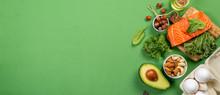 "Постер, картина, фотообои ""Keto diet concept - salmon, avocado, eggs, nuts and seeds, bright green background, top view"""