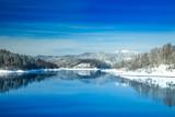 Beautiful peaceful lake in mountains in winter, nature landscape in Gorski kotar, Croatia