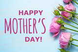 Happy mother's day text and pink roses on blue background