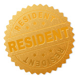 RESIDENT gold stamp reward. Vector gold medal with RESIDENT title. Text labels are placed between parallel lines and on circle. Golden area has metallic structure.