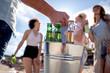 Leinwandbild Motiv Friends with beers on the beach