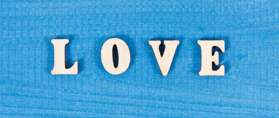 Word love on board as symbol of Valentines Day