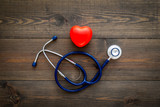 Heart health, health care concept. Stethoscope near rubber heart on dark wooden background top view copy space - 247906538