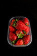 fresh strawberries in box isolated