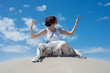 Woman sits on the sand and meditates
