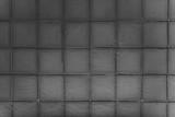 Dark gray tiles grunge textures background
