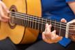 Playing guitar.