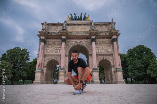 Man running in Paris near Louvre and Eiffel tower