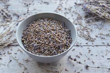 natural dry lavender flowers tea in ceramic bowl