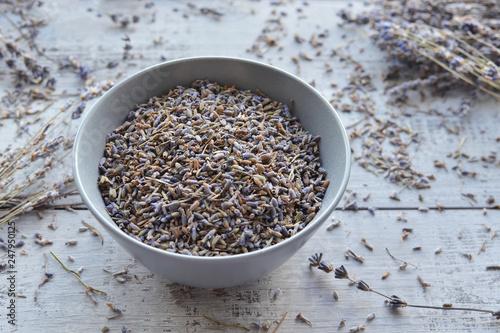 natural dry lavender flowers tea in ceramic bowl - 247950125