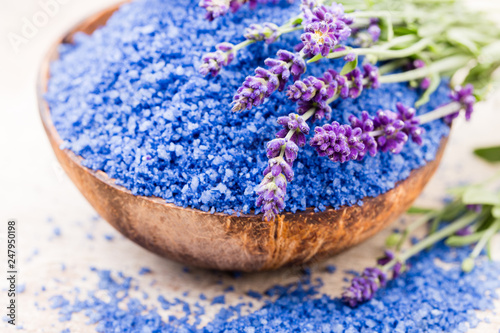 Essential lavender salt with flowers top view. - 247950198