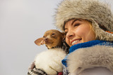 Woman hug warming her dog in cold day