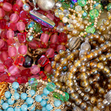 colorful gems and golden fashion jewels closeup, top view