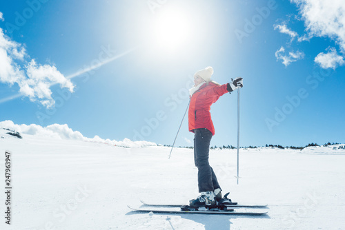 fototapeta na ścianę Woman enjoying her winter vacation on ski