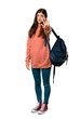 Leinwanddruck Bild - A full-length shot of a Teenager girl with sweatshirt and backpack making stop gesture denying a situation that thinks wrong
