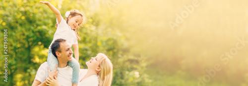 Leinwandbild Motiv Happy family: mother father and child daughter on nature on sunset