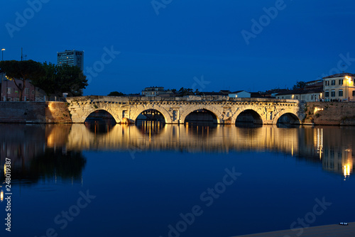 Tiberius bridge at night. Famous place in Rimini, Italy.