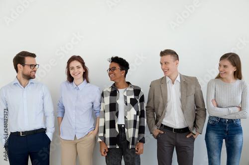 Leinwanddruck Bild Happy diverse professional team business people looking at female leader