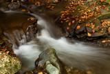 Waterfall inside autumn forest